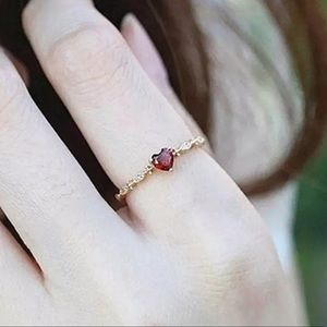 Beautiful gold ring with red ruby center heart